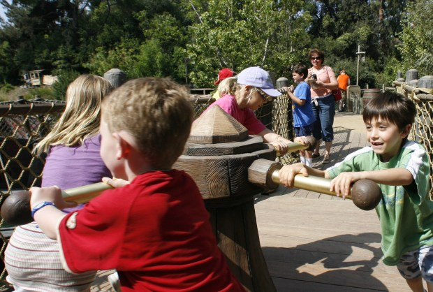 Children enjoy interactive elements Smuggler's Cove on Pirates Lair on Tom Sawyer's Island. (Photo by Joshua Sudock, Orange County Register/SCNG)