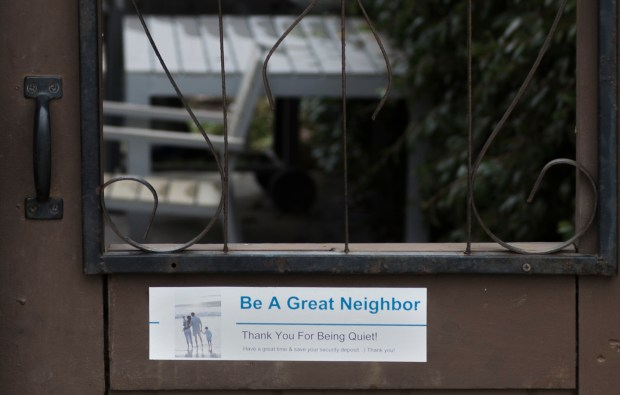 "A sign on a gate at a rental home on the 400 block of Virginia Street in El Segundo, Friday, January 12, 2018. El Segundo leaders are considering imposing fines on ""party houses"" that generate noise complaints. The move comes in response to a particular 5-bedroom house on Victoria Street running a short-term rental operation.  (Photo by Thomas R. Cordova Daily Breeze/SCNG)"