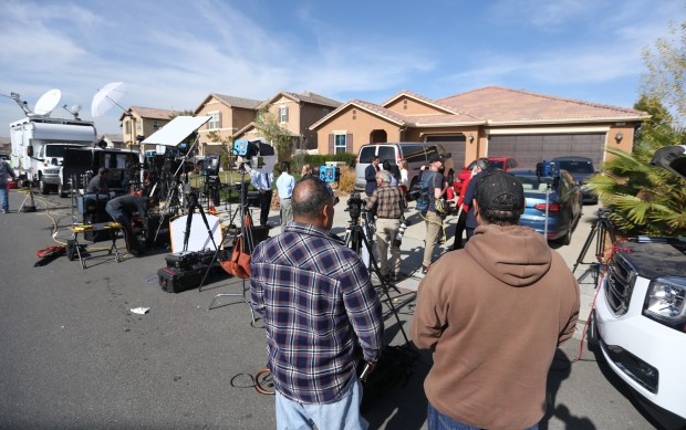 Residents look on as media set up on Tuesday, Jan. 16, 2018, outside the home on Muir Woods Road in Perris where authorities say 13 siblings had been held captive.(Stan Lim, The Press-Enterprise/SCNG)