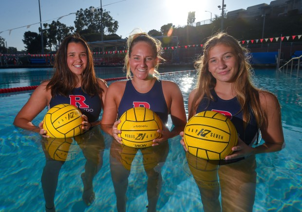 Redondo water polo players, from left, Kathy Wrightsman, Camille Grace and Kennedy East in their pool in Redondo Beach on Thursday, Jan 11, 2018. (Photo by Scott Varley, Daily Breeze/SCNG)