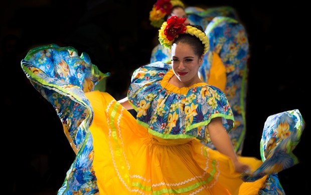 Dancers perform at a 2015 event at Cal State Fullerton. Emphasizing culturally relevant programs, policies and curricula are key to success for Latino students, according to the Education Trust. (Photo courtesy of Cal State Fullerton)