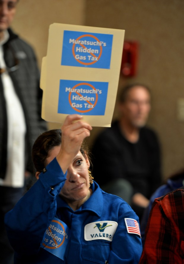 A Valero employee holds up a sign in the crowd as the South Coast Air Quality Management District board met on Saturday morning. The board met to hear officials present proposed new standards for the management of modified HF at PBF EnergyÕs Torrance Refining Co. and Valero Wilmington refineries. Torrance January 20, 2018. Photo by Brittany Murray, Daily Breeze/SCNG
