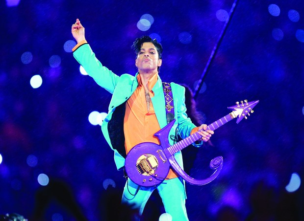 Prince performs during the halftime show at the Super Bowl XLI football game at Dolphin Stadium in Miami. (File photo by Chris O'Meara, Associated Press)