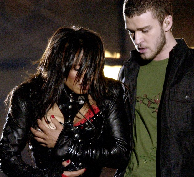 Entertainer Janet Jackson, left, covers her breast after her outfit came undone during the half time performance with Justin Timberlake at Super Bowl XXXVIII between the Carolina Panthers and New England Patriots in Houston, Sunday Feb. 1, 2004. (AP Photo/David Phillip)