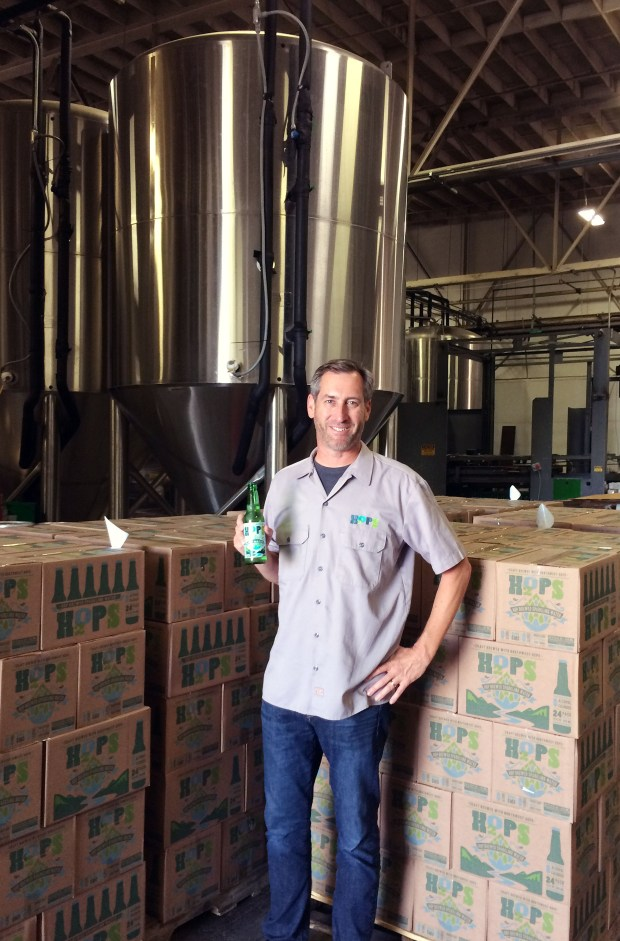 Paul Tecker contracts with craft breweries to make his hops-infused sparkling water, H2OPS. He's seen at Hermitage Brewing Co. in San Jose. (Photo courtesy of Paul Tecker)
