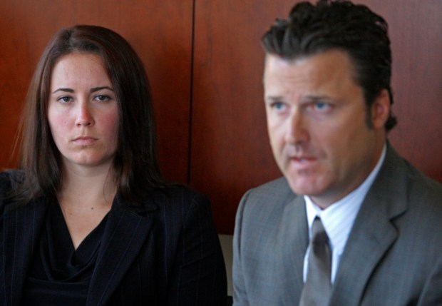 Jancy Thompson, left, sits near her attorney, Robert Allard, Wednesday, Aug. 11, 2010, in San Jose, Calif. The governing body of U.S. competitive swimming faces another lawsuit claiming it did not protect a young swimmer from being sexually abused by her coach. The lawsuit announced Wednesday accuses USA Swimming of negligence and says the organization was responsible for the coach's behavior. The suit claims swim coach Norm Havercroft sexually abused Thompson over a five-year period, beginning when she was about 15 years old. (AP Photo/Ben Margot)