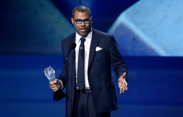 """Jordan Peele accepts the award for best original screenplay for """"Get Out"""" at the 23rd annual Critics' Choice Awards at the Barker Hangar on Thursday, Jan. 11, 2018, in Santa Monica, Calif. (Photo by Chris Pizzello/Invision/AP)"""