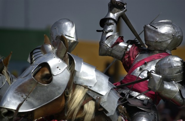 ORG XMIT: FAIRE (DI) Knights duel during the Queen's Royal Joust in the tournament area during the 39th annual Renaissance Pleasure Faire at Glen Helen Regional Park in Devore.