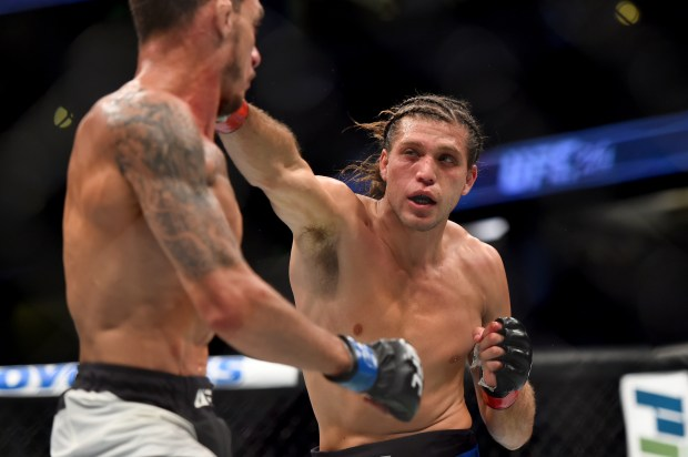 Brian Ortega, right, connects with Renato Moicano in the featherweight bout at UFC 214 at the Honda Center in Anaheim, Calif., Saturday July, 29, 2017. (Photo by Hans Gutknecht, Los Angeles Daily News/SCNG)