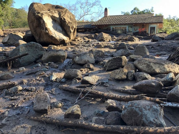 In this photo provided by Santa Barbara County Fire Department, homes were destroyed along San Ysidro Creek near East Valley Road in Montecito, Calif., Wednesday, Jan. 10, 2018. Runoff from heavy rain early Tuesday brought boulders, mudflow, and debris down on them. (Mike Eliason/Santa Barbara County Fire Department via AP)