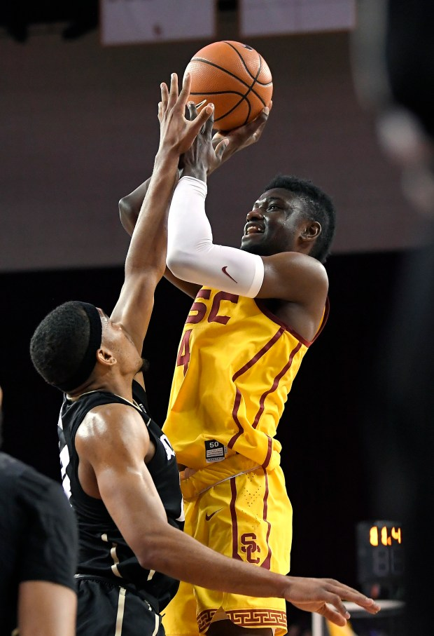 Southern California forward Chimezie Metu, right, shoots as Colorado guard George King defends during the second half of an NCAA college basketball game Wednesday, Jan. 10, 2018, in Los Angeles. USC won 70-58. (AP Photo/Mark J. Terrill)