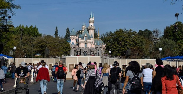 Temporary fencing surrounds The Hub in front of Sleeping Beauty Castle on Main Street, USA at Disneyland in Anaheim on Thursday, Jan 18, 2018. The park is replacing the horse-drawn streetcar track and brickwork along the street. All vehicle rides along the street are closed through early Spring. (Photo by Jeff Gritchen, Orange County Register/SCNG)