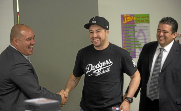 "FILE PHOTO. Ex-offender Grant Valencia shakes hands with life coach Richard Polanco Jr. and La Puente Councilman David Argudo before leaving for his job interview after attending the Los Angeles Sheriff's Department's ""Emerging Leaders"" program in La Puente on Wednesday, Jan. 29, 2014. Th program tries to reform ex-offenders by changing their mindset through educational programs taught by deputies in an effort to reduce recidivism. Grant Valencia is now a suspect in a drug trafficking case that prosecutors allege also involved a Los Angeles County Sheriff's deputy who worked with the ""Emerging Leaders"" program. (Photo by Watchara Phomicinda/ San Gabriel Valley Tribune)"