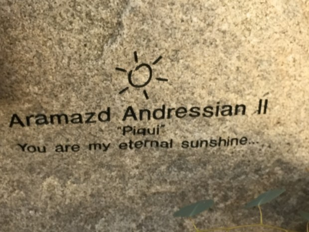 A close up of the boulder for Piqui Andressian recently added to the Children's Memorial and Healing Garden .