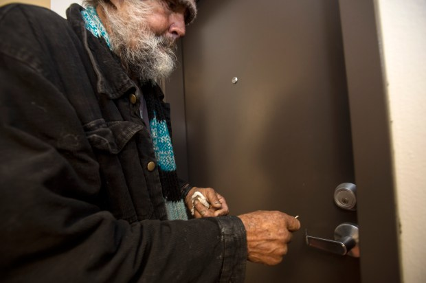 John McCullah, 73, enters his new apartment home at The Fiesta, Los Angeles Family Housing's 50-unit housing for the homeless in North Hollywood on Tuesday, Jan. 9, 2018. (Photo by Ed Crisostomo, Los Angeles Daily News/SCNG)