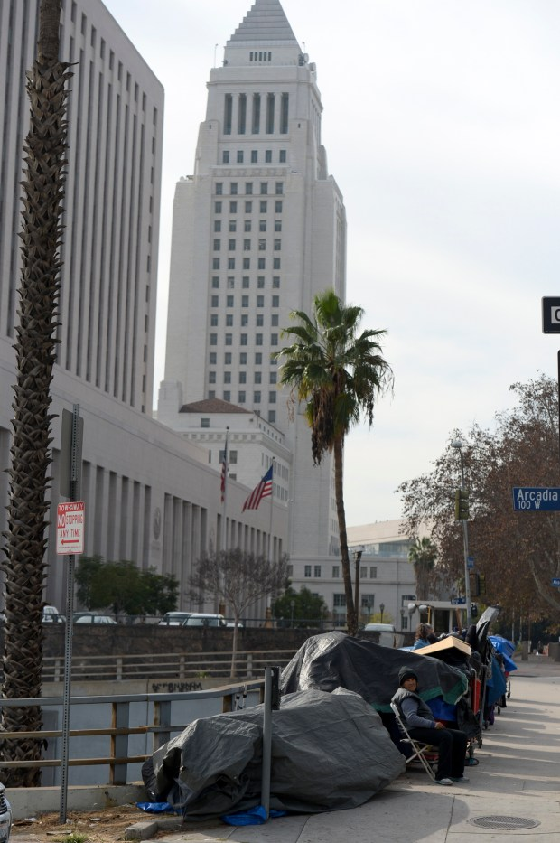 Los Angeles city leaders are planning to house dozens of homeless people in trailers on a city-owned downtown lot as a possible model for citywide temporary shelters. A proposal that will be submitted to the City Council today calls for installing five trailers on this parking lot at Arcadia and Alameda streets by the beginning of summer. ( Photo by David Crane, Los Angeles Daily News/SCNG)