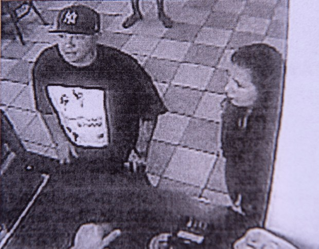 A video photo copy of a male, left, a suspect for the murder of 23-year-old Northridge resident Jorge Reyes Jr. The woman seen at the right, who police have named as Mallely Espinoza, 28, has been arrested on suspicion of being an accessory in the murder. (Photo by Ed Crisostomo, Los Angeles Daily News/SCNG)