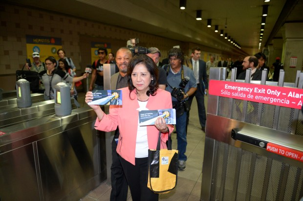 Los Angeles County Supervisor Hilda Solis hands out anniversary Tap cards at Union Station Monday. The line celebrated its 25th anniversary with a ride from Mayor Eric Garcetti who also passed out anniversary Tap cards to riders. ( Photo by David Crane, Los Angeles Daily News/SCNG)