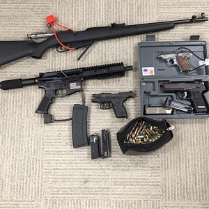 Long Beach police say they seized an assault rifle and other guns while arresting an attempted murder suspect in Wilmington on Jan. 12, 2018. (Courtesy Long Beach police.)