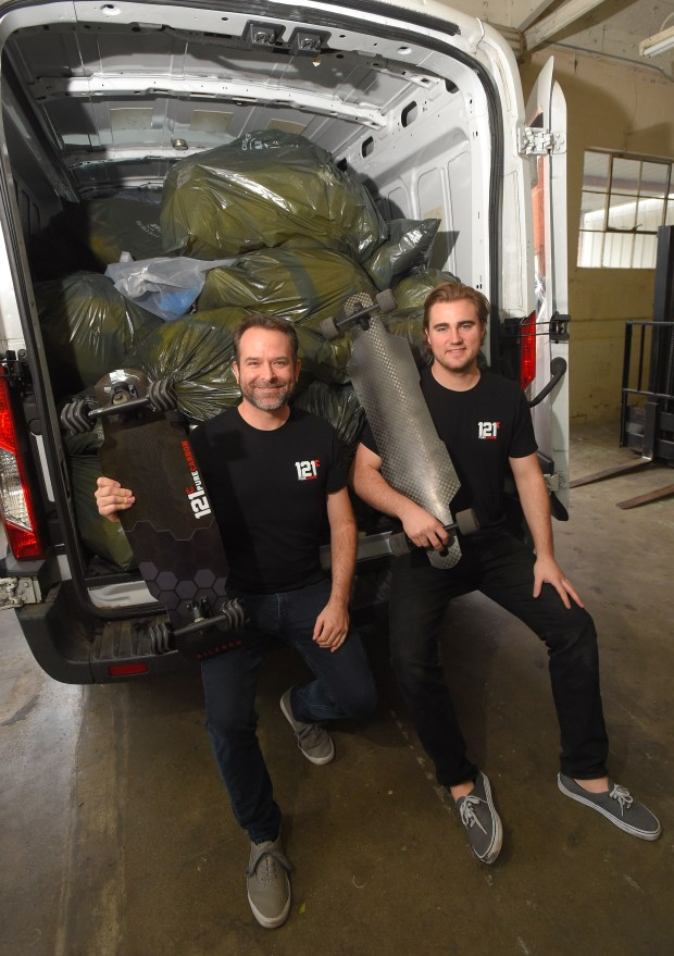 With a van full of bags of carbon fiber scraps from aerospace companies, Jaysen Harris, left, and Ryan Olliges make a variety of carbon firber products, including skateboard decks, at their company in Gardena on Monday, Jan 8, 2018. (Photo by Scott Varley, Daily Breeze/SCNG)