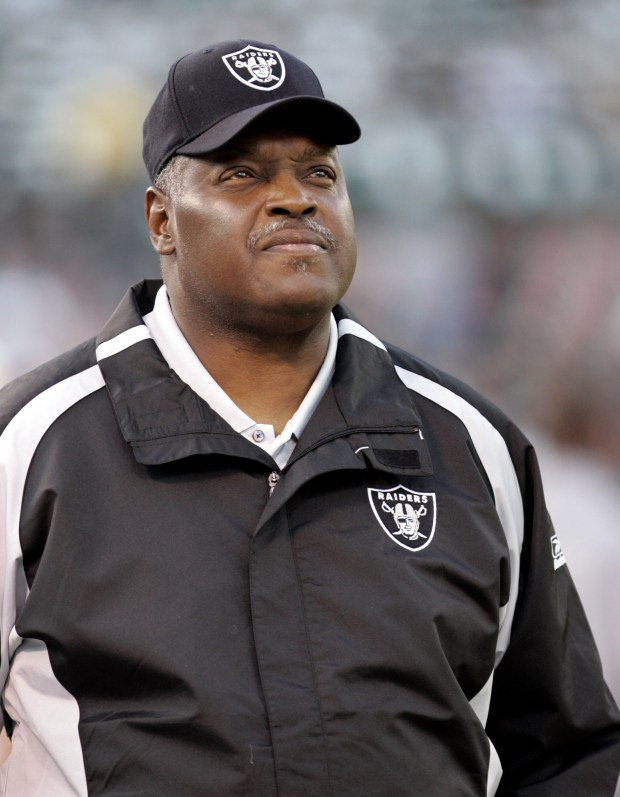 ORG XMIT: FX110 ** ADVANCE FOR WEEKEND EDITIONS, SEPT. 22-24 ** FILE ** Oakland Raiders head coach Art Shell walks the sidelines before their NFL football game against the San Diego Chargers, in this Sept. 11, 2006 file photo, in Oakland, Calif. Skeptics snickered when Oakland Raiders coach Art Shell turned his offense over to a bed and breakfast operator who hadn't coached in the NFL in more than a decade. Yet even the biggest doubters couldn't have imagined that the Raiders' performance under coordinator Tom Walsh would be this bad after two games. (AP Photo/Paul Sakuma)