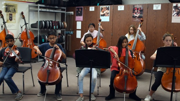 The Niguel Hills Middle School orchestra class practices music. (Photo courtesy of FundCru, Inc.)