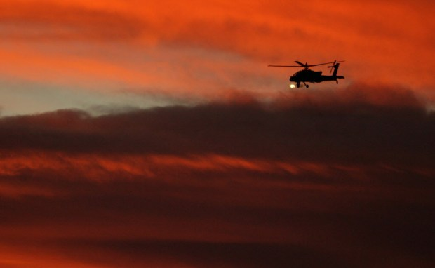 A helicopter fires its weapons into the evening during military exercises on Wednesday, Aug. 5 2015 at the U.S. Army's National Training Center at Fort Irwin. File photo.