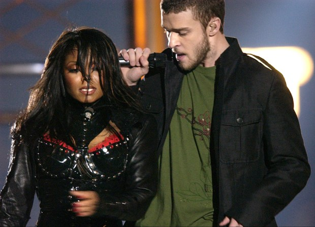 """In this Feb. 1, 2004 file photo, singers Justin Timberlake and Janet Jackson are seen during their performance prior to a wardrobe malfunction during the half time performance at Super Bowl XXXVIII in Houston. Timberlake says he has made up with Janet Jackson following the infamous """"wardrobe malfunction"""" at the Super Bowl in 2004. (AP Photo/David Phillip, File)"""