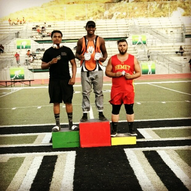 Citrus Hill High School senior Dubois Samuel, left, came in second place in shot put in 2017 league finals with a distance of 43 feet and 10 inches. Down Under Sports invited him to compete in their international tournament in July 2018. (Photo courtesy of Maya Samuel)