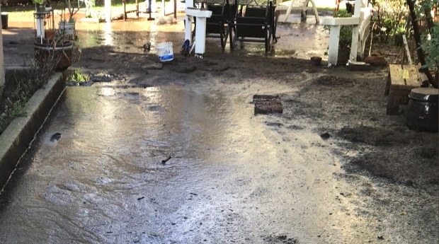 Mud invaded Corona homeowner Warren Kim's house Monday night. Photo by Shane Newell, Staff