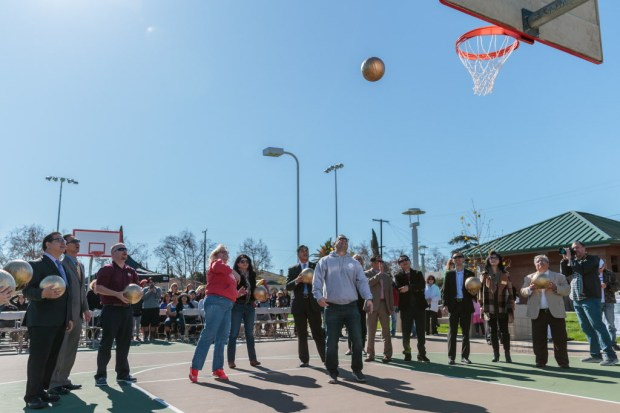 San Gabriel Mayor Juli Costanzo (center left) participates in the Ceremonial Hoop Shoot during the Marshall Park Opening Ceremony at Marshall Park in San Gabriel, Calif. on Saturday January 20, 2018. (Photo by Raul Romero Jr for the San Gabriel Tribune)