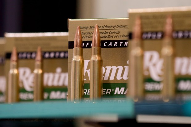 FILE - In this Jan. 15, 2013, file photo, Remington rifle cartridges are displayed at the 35th annual SHOT Show in Las Vegas. Remington, the gunmaker beset by falling sales and lawsuits tied to the Sandy Hook Elementary School massacre, said Monday, Feb. 12, 2018, that it has reached a financing deal that would allow it to continue operating as it files for Chapter 11 bankruptcy protection. (AP Photo/Julie Jacobson, File)