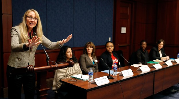 Nancy Hogshead-Makar, three-time Olympic swimming gold medalist, speaks during a media briefing to highlight the role of Title IX and commemorating the 32nd Annual National Girls & Women in Sports Day on Capitol Hill, Wednesday, Feb. 7, 2018 in Washington. Critics like Hogshead-Makar said the continued high rate of incidents of sexual abuse is largely the result of USA Swimming's failure to implement policies that would create effective deterrents.(AP Photo/Alex Brandon)