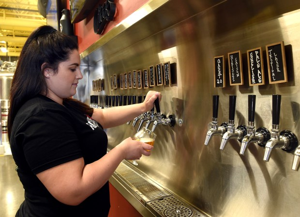 Manager Alex Doonan pours a beer inside the Rescue Brewing Company in downtown Upland, CA., Thursday, February 15, 2018. (Staff photo by Jennifer Cappuccio Maher, Inland Valley Daily Bulletin/SCNG)