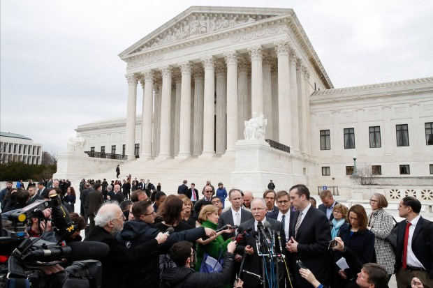 Illinois government employee Mark Janus speaks to the media outside the Supreme Court, Monday, Feb. 26, 2018, in Washington. The Supreme Court takes up a challenge Monday in a case that could deal a painful financial blow to organized labor. The court is considering a challenge to an Illinois law that allows unions representing government employees to collect fees from workers who choose not to join. (AP Photo/Jacquelyn Martin)