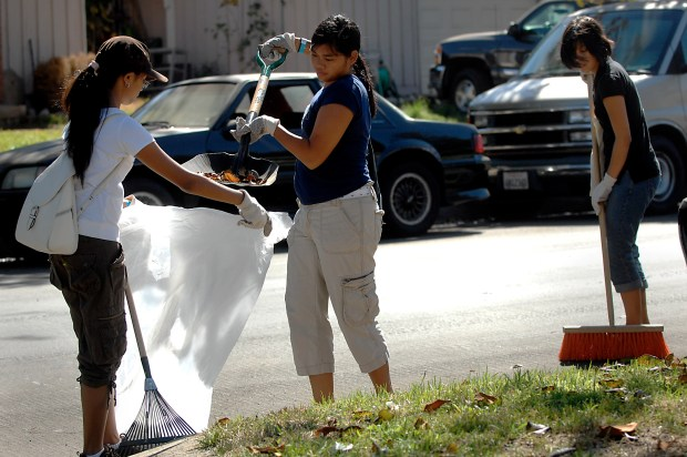 Jiezl Valenzuela, Yasmine Balatbat and Camille Suarez help clean up a street during the Panorama City Community Cleanup on September 15, 2007. (photo by Evan Yee, Los Angeles Daily News Staff Photographer)