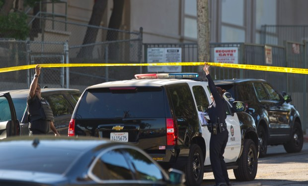 Los Angeles police cordon off the Belmont High School in Los Angeles Thursday, Feb. 1, 2018. Two students were shot inside a classroom at the neighboring Sal Castro Middle School Thursday morning and police took a female student into custody, authorities said. (AP Photo/Damian Dovarganes)