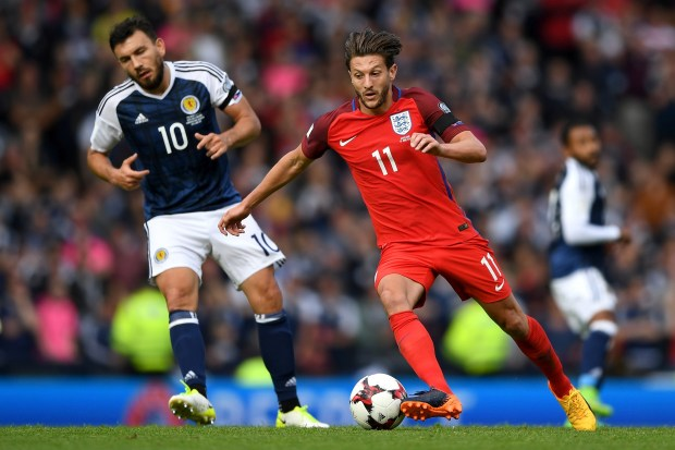 Adam Lallana of England takes the ball past Robert Snodgrass of Scotland during the FIFA 2018 World Cup Qualifier between Scotland and England at Hampden Park National Stadium on June 10, 2017 in Glasgow, Scotland. (Photo by Shaun Botterill/Getty Images)