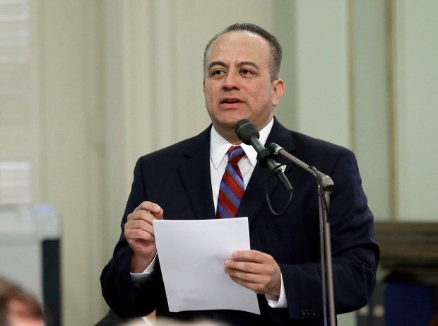 ADDS THAT HE WAS NOT AN ELECTED OFFICIAL AT THE TIME OF THE ALLEGATION - FILE - In this May 4, 2017, file photo, Assemblyman Raul Bocanegra, D-Los Angeles, speaks at the Capitol in Sacramento, Calif. Bocanegra said Monday, Nov. 20, 2017, he won't seek re-election following allegations he sexually harassed a colleague in 2009 when he was a staff member for another assemblyman. (AP Photo/Rich Pedroncelli, File)