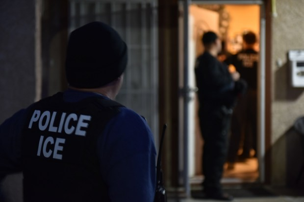 U.S. Immigration and Customs Enforcement agents conduct an operation is Los Angeles on Sunday, Feb. 11, 2018. (Photo by Peter Nissen, courtesy ICE)