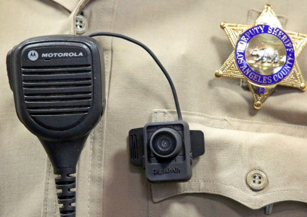 This Sept. 22, 2014 file photo shows a body camera on the uniform of a Los Angeles County Sheriff's deputy at department headquarters in Monterey Park. (AP Photo/ Nick Ut, File)