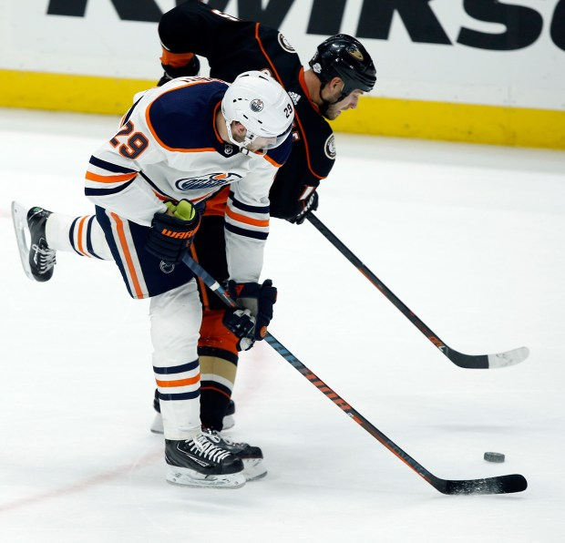 Edmonton Oilers center Leon Draisaitl, left, of Germany, works for the puck against Ducks center Ryan Getzlaf during the third period of an NHL game in Anaheim Friday, Feb. 9, 2018. The Ducks won 3-2. (AP Photo/Alex Gallardo)