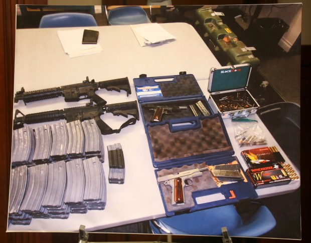 A confiscated cache of weapons is displayed at a news conference in Los Angeles on Wednesday, Feb. 21, 2018. Authorities say a student's plot for a mass shooting at a South Whittier high school was thwarted by a school safety officer who overheard the suspect discussing the plan. Officials say more people are coming forward with tips about threats.(AP Photo/Mike Balsamo)