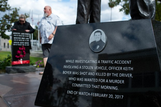 Nancy and Don Clark, parents of slain Officer Keith Boyer, visit the Whittier Police Memorial on Wednesday, Feb. 14, 2018. On the evening of Feb. 20 there will be a remembrance at the memorial for Boyer to mark one year since he was fatally shot, allegedly, by known gang member Michael Mejia. (Photo by Sarah Reingewirtz, Pasadena Star-News/SCNG)