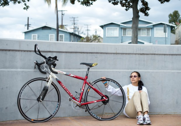 Sylvia Ramos visits Whittier's Peace Memorial with the bike that is going to be part of a monument to honor her late husband Jose, founder of Welcome Home Vietnam Veterans Day, on Wednesday, Feb. 14, 2018. The Peace Memorial is one of the sites in consideration for the man who rode his bike across the country for veterans. (Photo by Sarah Reingewirtz, Pasadena Star-News/SCNG)