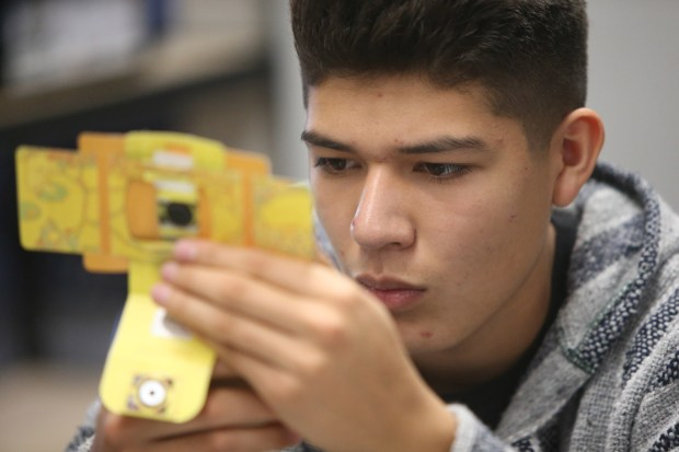 Ramon Sanchez, 17, assembles a paper microscope during an engineering class at Rancho Verde High School in Moreno Valley on Monday, March 5.<br /> Photo by Stan Lim, The Press-Enterprise/SCNG