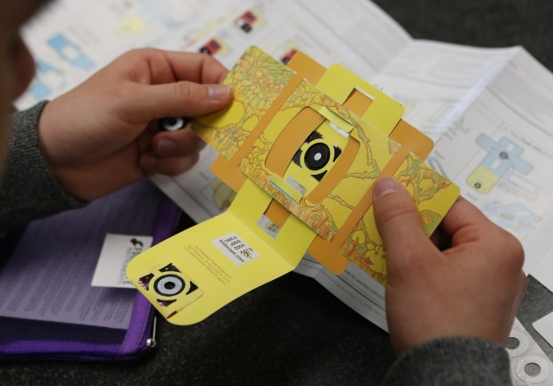 Students in Bruce Hill's engineering class construct an inexpensive, paper-based microscope called a Foldscope. Photo by Stan Lim, The Press-Enterprise/SCNG
