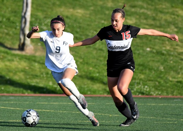 Flintridge Prep's Makenna Dominguez (9) fights for the ball against Corona Centennial's Deniah Wells (15) in the second half of a CIF State girls soccer regional semifinal at Glendale Soccer Complex in Glendale, Calif., on Thursday, March 08, 2018. Flintridge Prep won 1-0. (Photo by Keith Birmingham, Pasadena Star-News/SCNG)