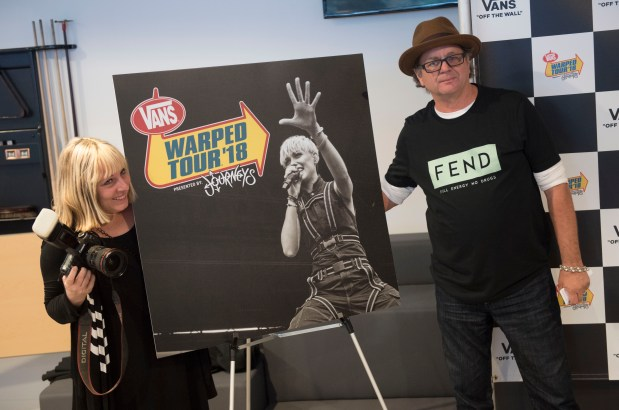 Rock photographer Lisa Johnson, left, and Vans Warped Tour producer Kevin Lyman pose next to the program cover for this years' tour, the last one, during the Vans Warped Tour Kick-Off Party at the Vans Global Headquarters in Costa Mesa on Thursday, Mar. 1, 2018. (Photo by Kevin Sullivan/Orange County Register/SCNG)