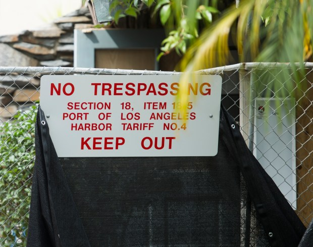 A sign and chain linked fence is erected next to the Ports O' Call Restuarant in San Pedro Monday, March 12, 2018. (Photo by Thomas R. Cordova / Daily Breeze)
